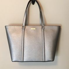 "kate spade | newbury lane | dally Beautiful brand new Kate spade dally tote in anthracite! Approximately 11.5"" tall, 6""wide, 19"" long at top, 13"" long at bottom. No dust bag. kate spade Bags Totes"
