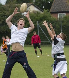 Britains Prince Harry enjoys a game of touch rugby with young children at the Inspire Suffolk centre for young people in Ipswich, eastern England, Thursday May 29, 2014. The prince began his day at the youth organisation which uses education and sport to improve young people's lives. (AP Photo/Arthur Edwards, Pool)