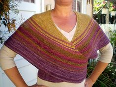 Cute! It's a shawl that ties so it stays in place!