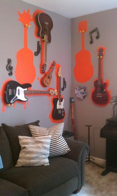 Who needs art when we could just display our electric and acoustic instruments like this?