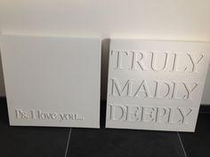 Wit canvas met houten letters....