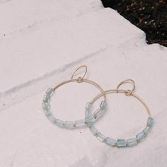 Jolie Circle earrings in sky blue topaz