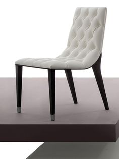 World class Luxury Italian chair shown here in our white leather with a high gloss lacquered frame.