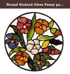 Round Stained Glass Pansy panel, multicolored. Glass pansies in many colors along with lots of green, all of it framed in a metal frame with hangers attached, ready to enjoy. Background glass is clear plateglass. 11' diameter. Each will be colorful and always a bit different from each other since I use fine Artglass which is unique and rarely duplicated.
