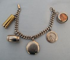 Unique Vintage Gold Tone Charm Bracelet including a Cigarette Scope and a Barrel with Dice