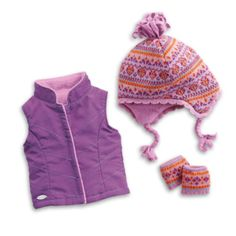Warm winter layers ensure that dolls who love the outdoors are kept cozy. These great accessories include: A purple woven vest with princess seams, a stand-up collar, and a cuddly fleece lining, A Fai