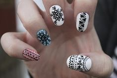 Love the black and white hearts with dots nail art design