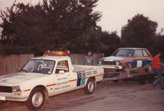 504 pickup loading 104 Rally car in West Lavington after competing on Salisbury Plain
