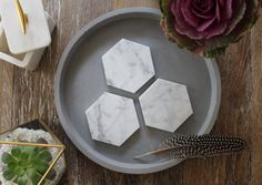 These beautiful pure carrara marble hexagons make for great coasters, candle holders or decorative objects around the home.