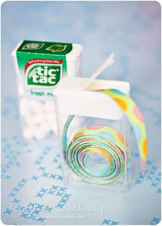 This is an awesome idea for the small spools of ribbons. Tic Tac anyone?