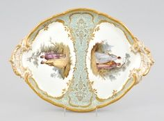 Royal KPM Scenic porcelain platter-tray ~ An oval shape porcelain double handled tray ~ Depicting hand painted courting scenes in reserves surrounded by raised cartouches on aqua background with fine gilt details ~ Circa 19th century