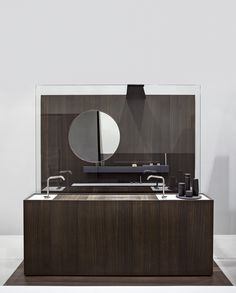 MODULO30 is a floorstanding cabinet consisting of modules 30 cm each with integrated full-length washbasin, here displayed in smoked oak and Carrara marble.