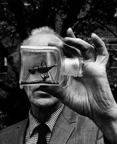 """Joseph Cornell holding an Untitled Bottle Object"" (photographer: Duane Michals, c. 1969)"