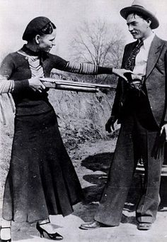 Clyde Barrow and Bonnie Parker mugging for the camera.