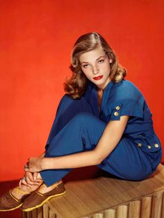 Lauren Bacall's shoes and navy outfit from 1945 would look great right now. Her hair and lipstick elevate the look from casual to glam.
