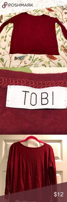Tobi Red Top This red top is fitted on the arms and flow around the torso. Its super soft and comfortable. Never been worn and in excellent condition. Tobi Tops Blouses