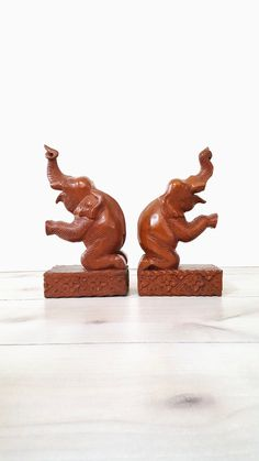 Your place to buy and sell all things handmade Elephant Home Decor, Vintage Elephant, Hand Carved, Carved Wood, Bookends, Thailand, Lion Sculpture, Carving, Desk Accessories