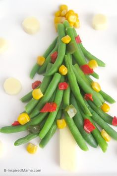Create a vegetable Christmas vegetable tree for a fun holiday lunch with the kids.