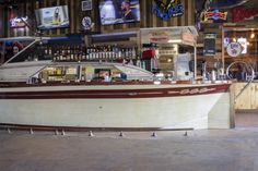 Dry Dock 28 in Ocean City has a boat shaped bar and boats hanging from the ceiling. #ocmd