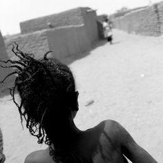 "1997. © Bernard Descamps - ""The gift of the river"", Mali, Sendégué, Street in the village"