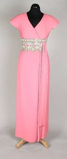Balmain Haute Couture evening dress from 1969, floor length with capped sleeves, v neckline with crossover detail and an ornately hand beaded waistband, labelled Pierre Balmain Patrons Printemps. House of Balmain.