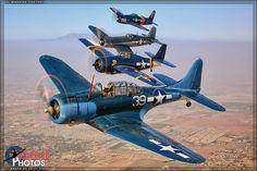 Douglas SBD-5 Dauntless, F4F/FM-2 Wildcat, F4U-1A Corsair, and F8F-2 Bearcat. (Front to Back)