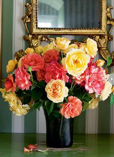 get silk flowers to make up this arrangement.  and spray paint a cheap clear vase from thrift store.