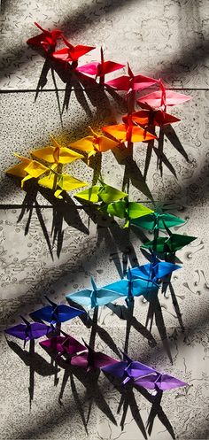"foxycleverpatra: ""ROY G. BIV Paper Cranes, At Mi Casa - April 16, 2013 I took this by my window. Really liked the color against the lines and patterns. """