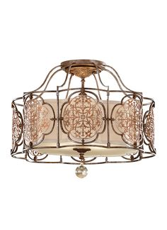 The Marcella lighting collection by Feiss is inspired by the lushness and vitality of the Mediterranean - particularly with the fixture's ornate, laser-cut medallions and crystal drop details. In addition to this semi-flushmount, the collection includes large pendants and a wall sconce.