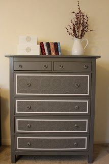 Updated Dresser - Paint. Update Drawers Using Ceiling Tiles, Wallpaper, etc. and Molding. Add New Knobs.