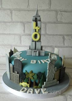 40th birthday cake, New York themed.  Yellow cabs, empire state, NYC skyline and the statue of liberty all feature!