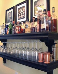 "Make your own ""Bar"". Use custom built shelving to display your collection of bottles and glassware. - fabuloushomeblog.com"