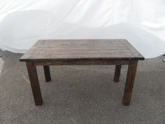 Reclaimed Wood Dining Table  Reclaimed wood farmhouse style dining table. Cute and sturdy and ready to serve. Made entirely out of reclaimed wood.  Measurements are approximately 56″W x 31″D x 30″H.  Item # 1565-925