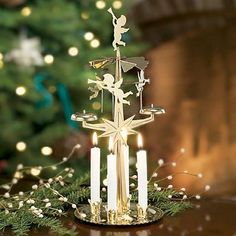 Swedish Angel Chimes: Such a sweet tradition! Heat from the burning candles rises and turns the turbine to ring the bells! (Perfect for a science demo!) #Angel_Chimes