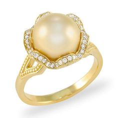 A 14K yellow gold ring set with one semi-round South Seas Pearl, 10-11mm and golden in color, and forty-two faceted round Diamonds totaling 0.21 carats, total w