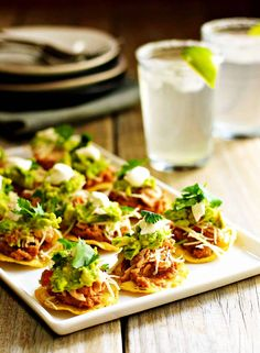 Healthy Snacks Chicken Tostadas are a Mexican food favorite! Healthy, festive and delicious with shredded chicken, refried beans, cheese, guacamole! One of those perfect recipes for Cinco de Mayo or any party! Healthy Superbowl Snacks, Healthy Appetizers, Appetizers For Party, Appetizer Recipes, Healthy Recipes, Quick Snacks, Vegan Snacks, Tostada Recipes, Guacamole