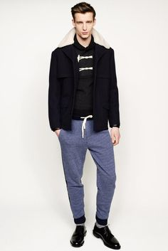 This combo of a navy fur collar coat and blue sweatpants makes for the perfect base for a myriad of stylish outfits. For something more on the classier end to complement this look, finish off with black leather derby shoes. Hipster Outfits, Hipster Fashion, Mens Fashion, Fashion Outfits, Fall Fashion, Fashion 2014, Rugged Style, Vogue Paris, Mens Sweatpants