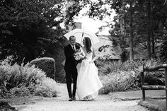 Who Even Cares If It S Raining Jen And Mitch At Wyresdale Park Embracing The Weather Wyresdaleweddings Rai Umbrella Wedding Rainy Wedding Wedding