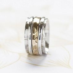 Karma Bronze And Silver Spinning Ring from notonthehighstreet.com