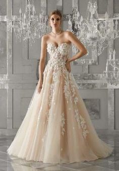 Nice Romona Keveza blush wedding dress with sweetheart neckline beaded belt and flowing full skirt