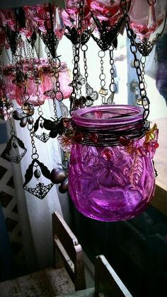 Paint a glass jar, wrap it with wire, add chain and decorate with beads, jewelry charms.