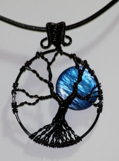 This is AWESOME! A blue moon tree of life pendant... LOVE IT!