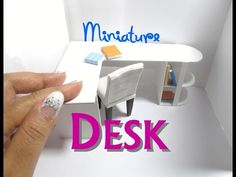 I used 6 super jumbo popsicle sticks, 5 jumbo popsicle sticks, and 1 coffee stirrer stick to create this L-shaped desk modern desk. I painted it white to mat...