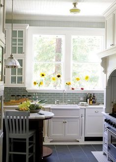 Light blue and white kitchen, with bright sunflowers!