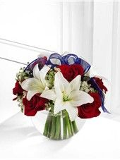Independence Day Bouquet- Brilliant red roses and white Asiatic lilies are delicately accented with Queen Anne's Lace and a sheer blue ribbon all perfectly presented in a clear glass bubble bowl vase. For delivery in San Diego Blue Flowers Bouquet, Get Well Flowers, Flower Factory, Flower Words, Blue Centerpieces, White And Blue Flowers, Order Flowers Online, Same Day Flower Delivery, Flowers Delivered
