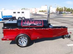 Jambo Pits' offset smokers produce award winning BBQ in sleek, colorful trailer mounted rigs that often resemble hot rods. Bbq Smoker Trailer, Bbq Pit Smoker, Barbecue Pit, Bbq Grill, Custom Bbq Smokers, Custom Bbq Pits, Bbq World, Bbq Equipment, Texas Bbq