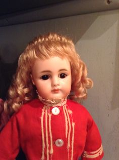 Hand-wefted blonde up style mohair wig with ringlets.