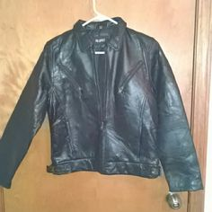 Leather moto style jacket Leather patchwork style moto inspired jacket. Has adjustable side sinchers. Two pockets up high, two hand pockets, along with one interior pocket. Jackets & Coats
