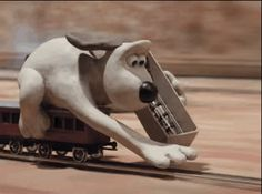 "When Gromit laid down his own tracks in this train chase: | 33 Charming Moments From ""Wallace And Gromit"" That Will Make You Laugh Every Time"