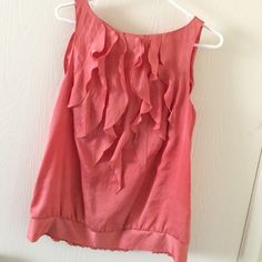 Peach Coral Sleeveless Ruffled Blouse Gorgeous coral peach color. Perfect for spring. Wear it with slacks for the office or some skinnies and heels for a night out. Sleeveless. Ruffles in front. Very flattering. Ann Taylor Tops Blouses